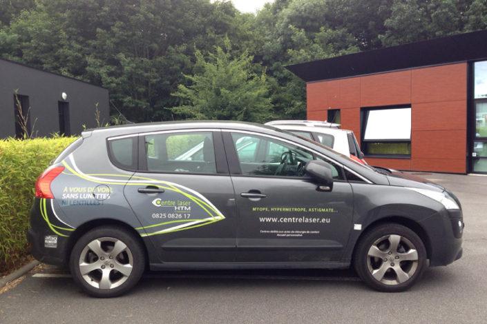 Impression et pose d'adhésif pour un marque sur voiture pour la société Centre Laser HTM à Nantes