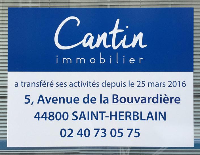 Adhésif sur vitrine pour prévention déménagement Cantin Immobilier Saint Herblain Nantes