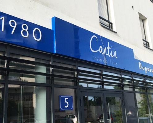 Enseigne caisson tôle pour l'agence immobilière Cantin Immobilier à Saint Herblain Avenue de la Bouvardière (44)