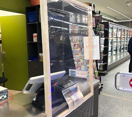 Film de protection avec cadre bois pour caisse Nantes Centre - Label Enseigne Nantes